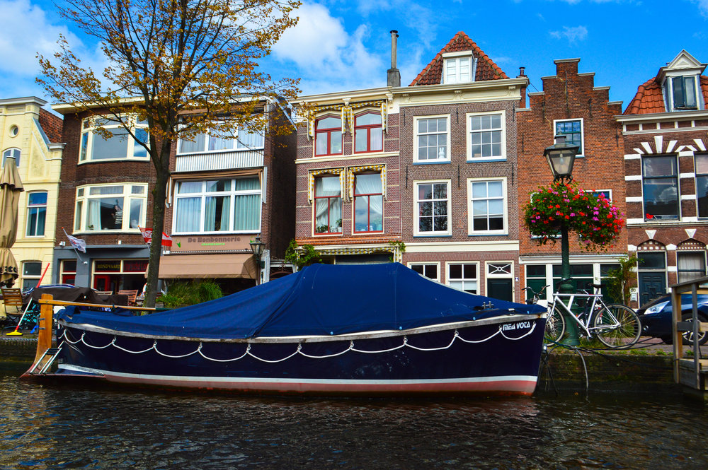 Classic Dutch houses and boat on a boat cruise of Leiden