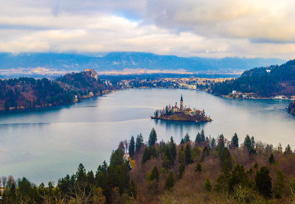 winter slovenia lake bled hiking to the viewpoint, church in the lake, Julian Alps, icey