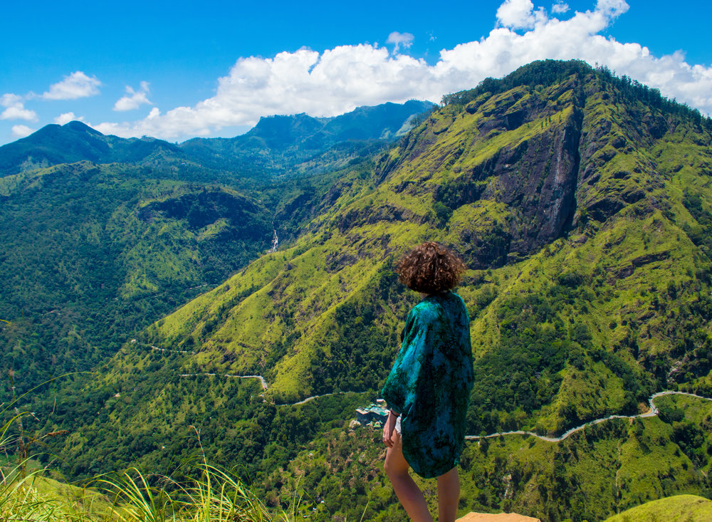 Admiring the mountaneous view from the top of Little Adam's Peak.