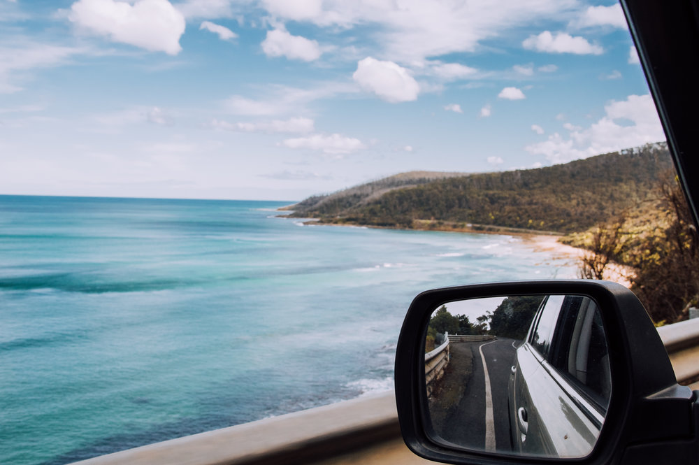 Great ocean road and sea from rolled down window of car