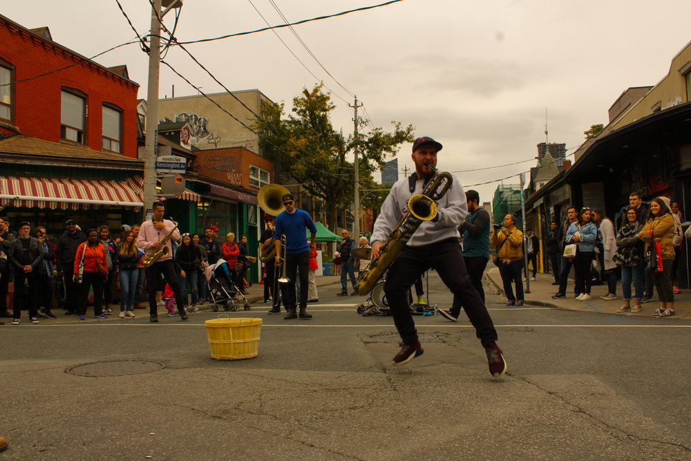 A street brass band playing on the streets on Kensington Market