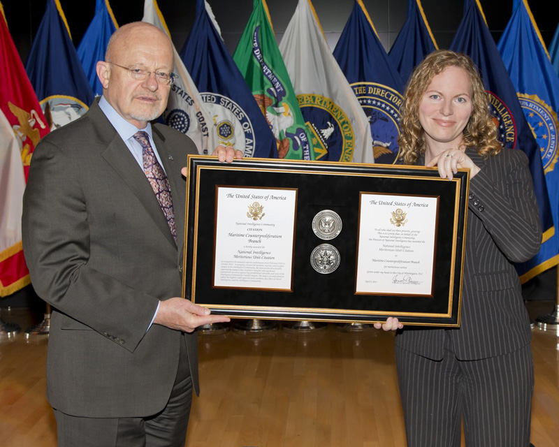 Alexandra Chandler with former Director of National Intelligence James Clapper