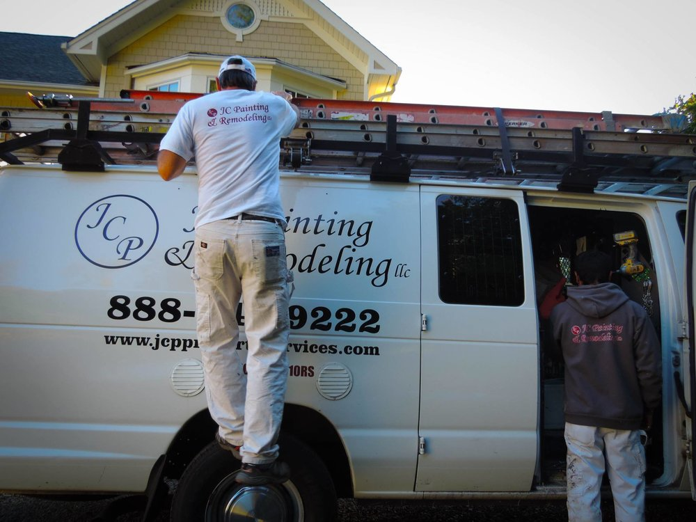 The best painters around loading up our JC Painting & Remodeling truck at a beautiful job on the shore of the puget sound.