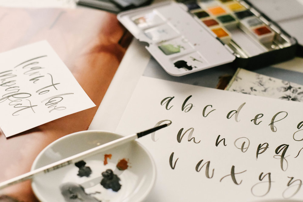 lettering - Whether you are looking for a unique invitation, a simple logo design, or custom day-of-piece for your next big event, we've got you covered!  Learn more here about our lettering services here!