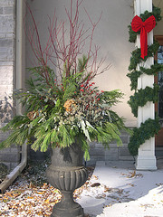 Red dogwood, pine, cedar, magnolia leaves, pepperberries, hydrangea blooms, seeded eucalyptus