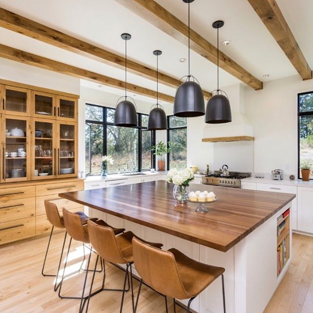 Love this fresh look of white walls and natural wood elements. It's modern but still has a ton of character! We used @caesarstoneus for the countertops and @crosscuthardwoods for the island.