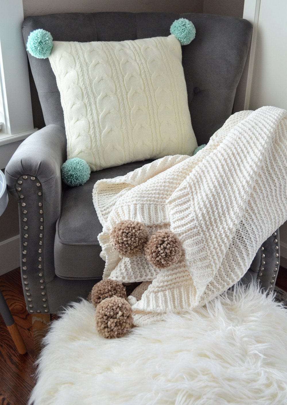 cozy up your home adding pom poms and tassels to blankets and