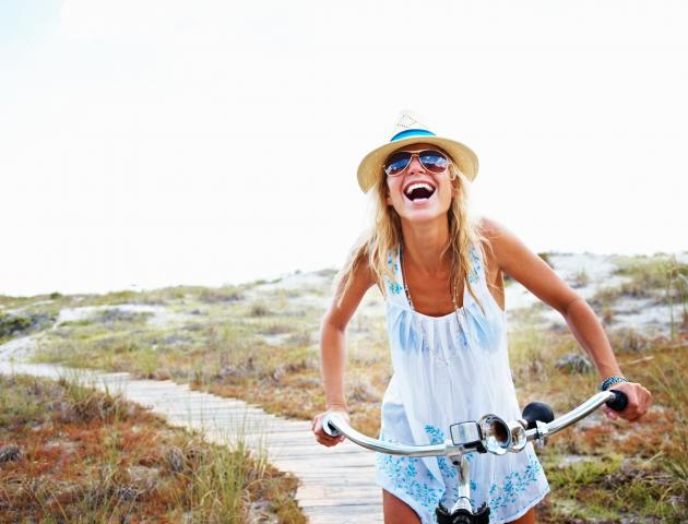 woman_cycling_laughing