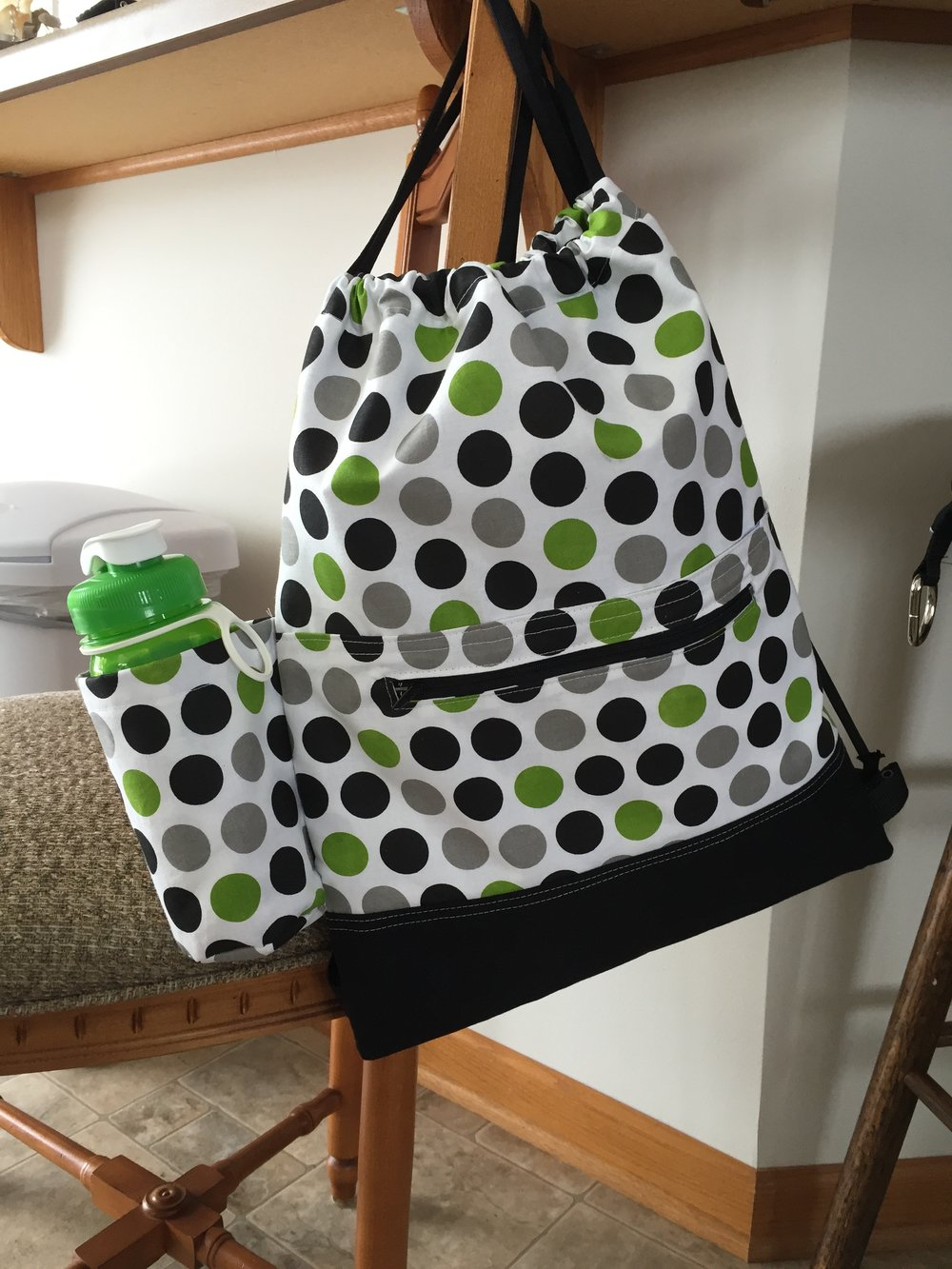 Drawstring backpack with bottle holder