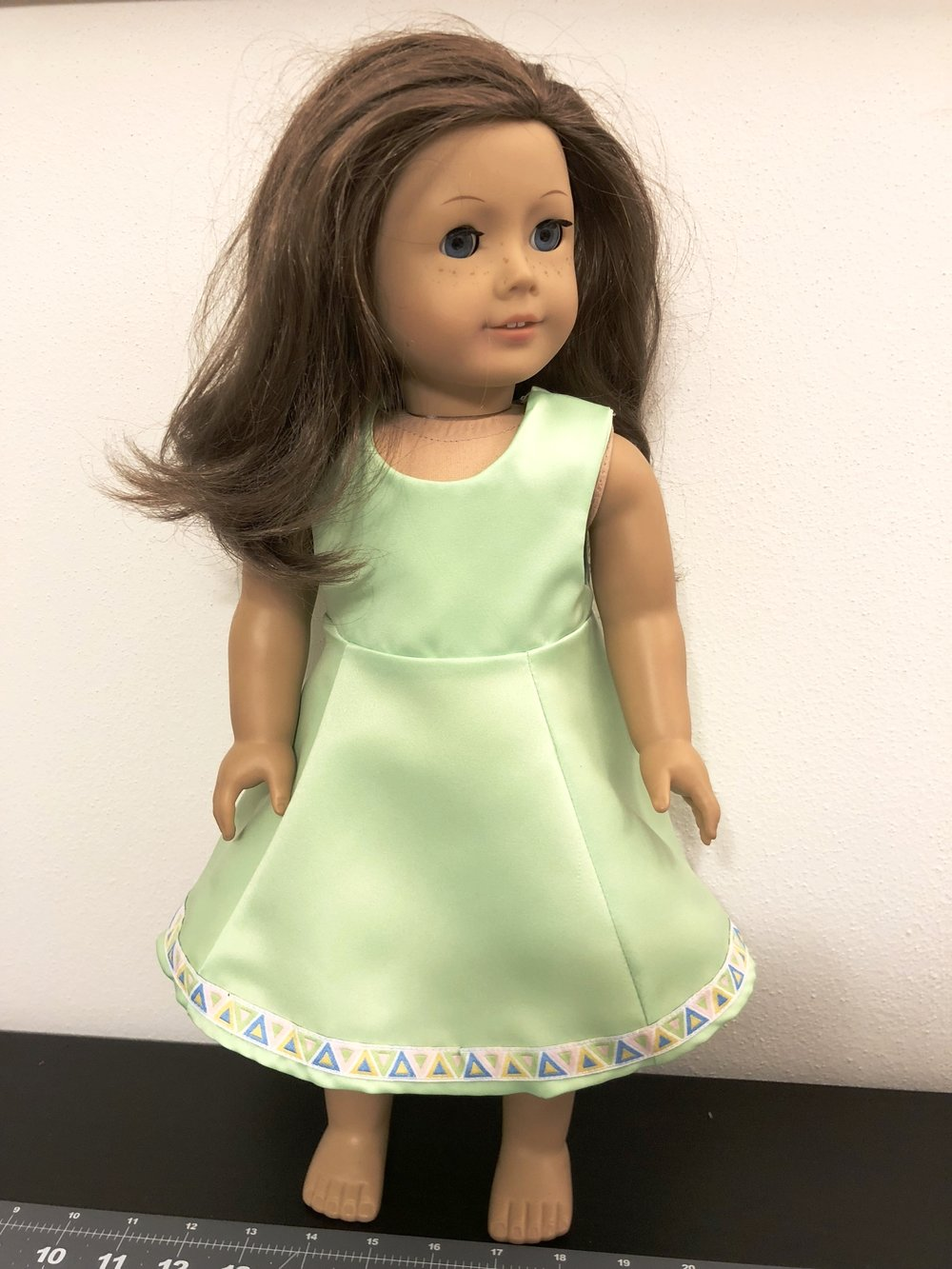 Green matte satin dress with ribbon embellishment. Simple. Girly.