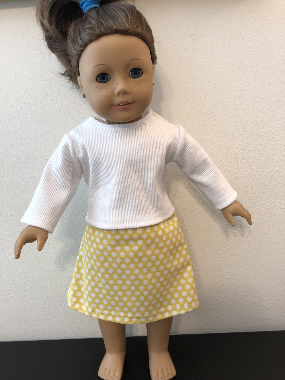 Rib knit shirt with yellow polka dot skirt