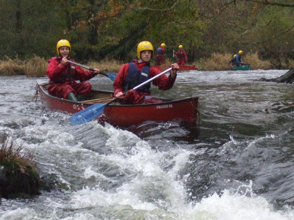 canoe on rapid.jpg