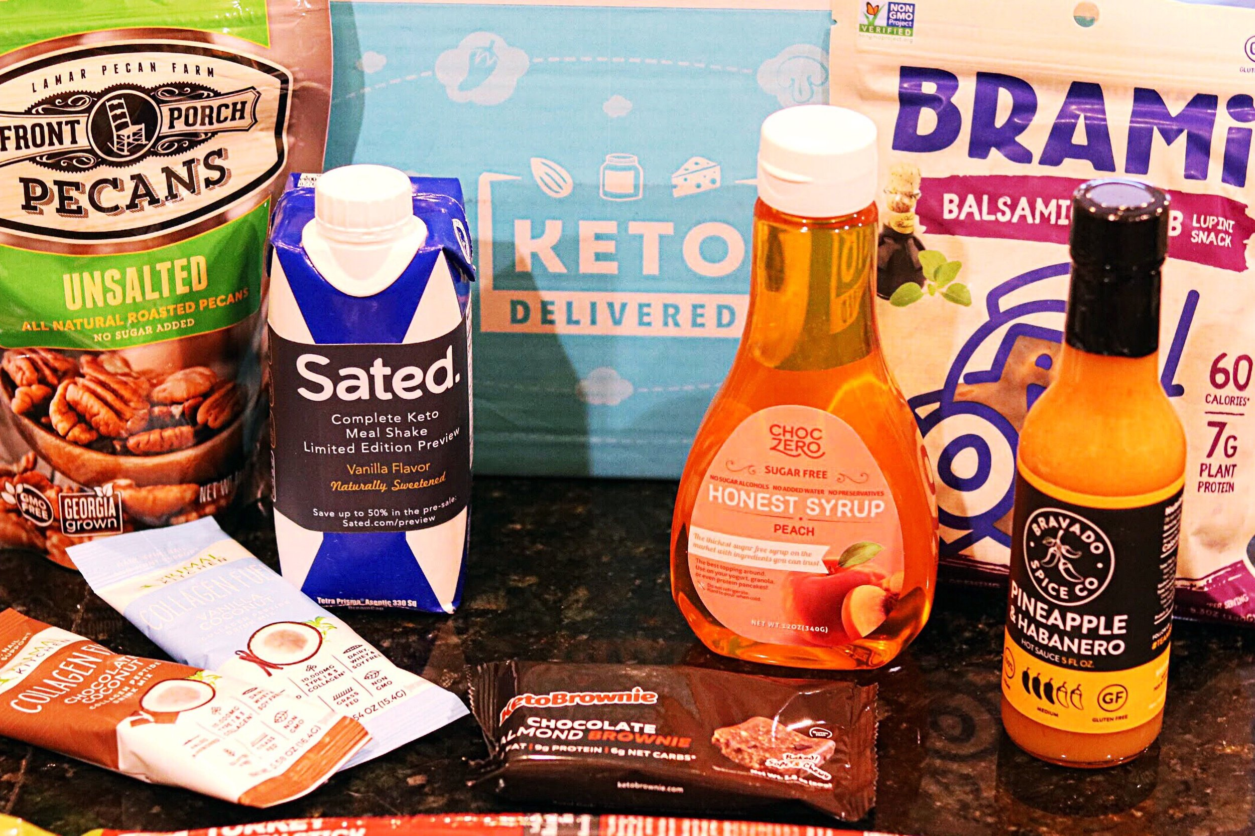 An assortment of items for a monthly keto snack box