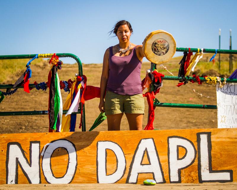 """TK'EMLUPS Woman Warrior"" September 17th, 2016 at the Dakota Access Pipeline crossing near Cannonball, ND"