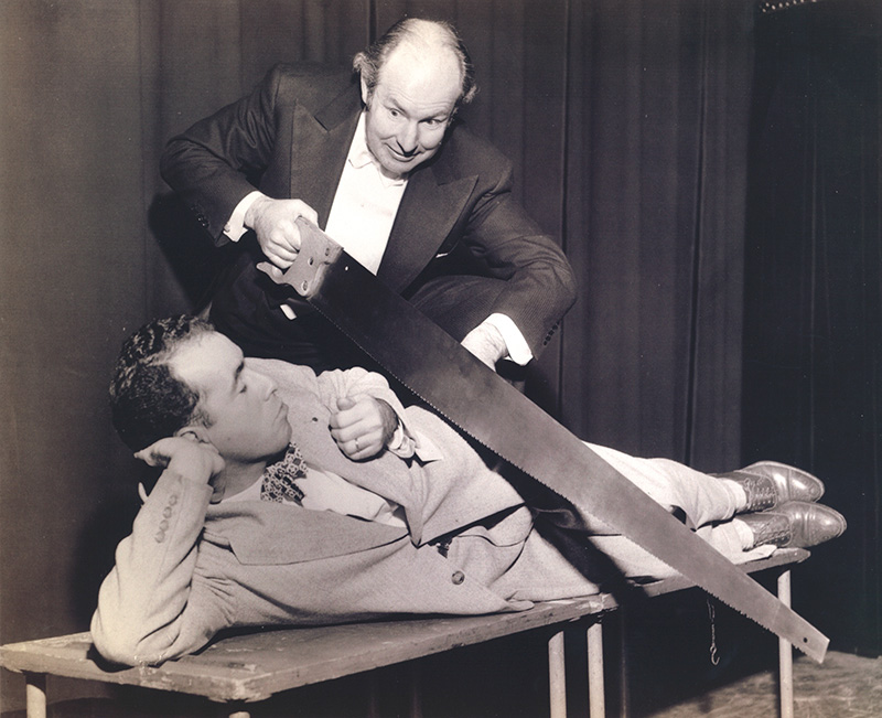 1950 - as a young San Diego newspaperman, he was sawed in half by the Great Virgil.