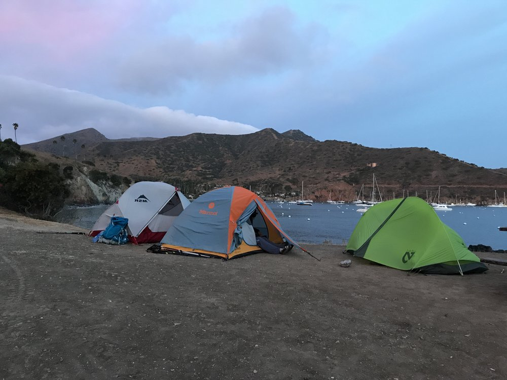 A gorgeous array of high quality tents at sunrise. Two Harbors, Catalina Island. The TransCatalina Trail is one of the best backpacking trips in California!
