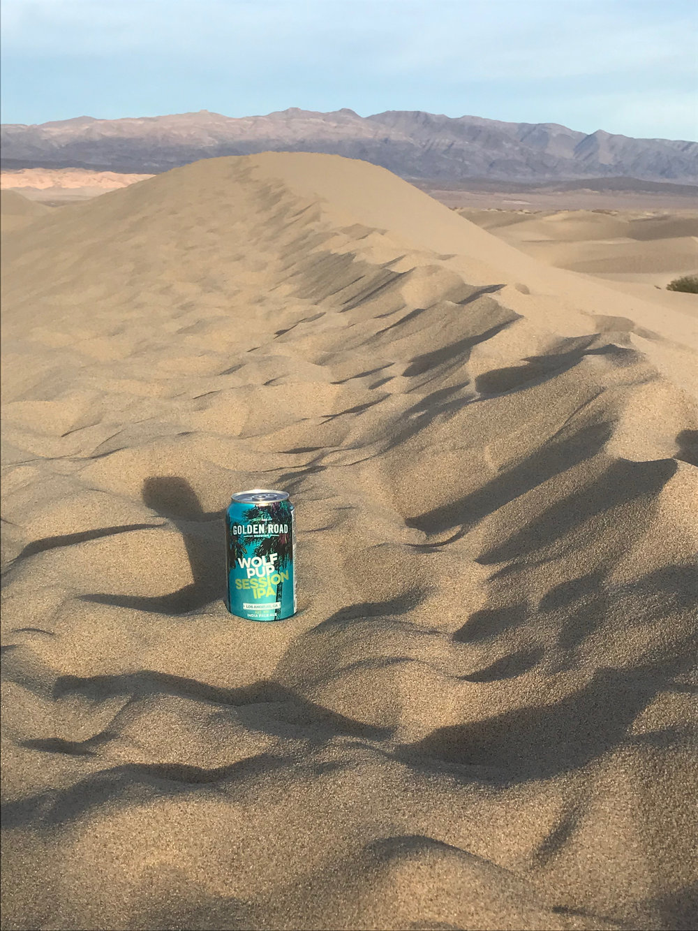 Sometimes a good IPA is worth the extra weight. Death Valley National Park.