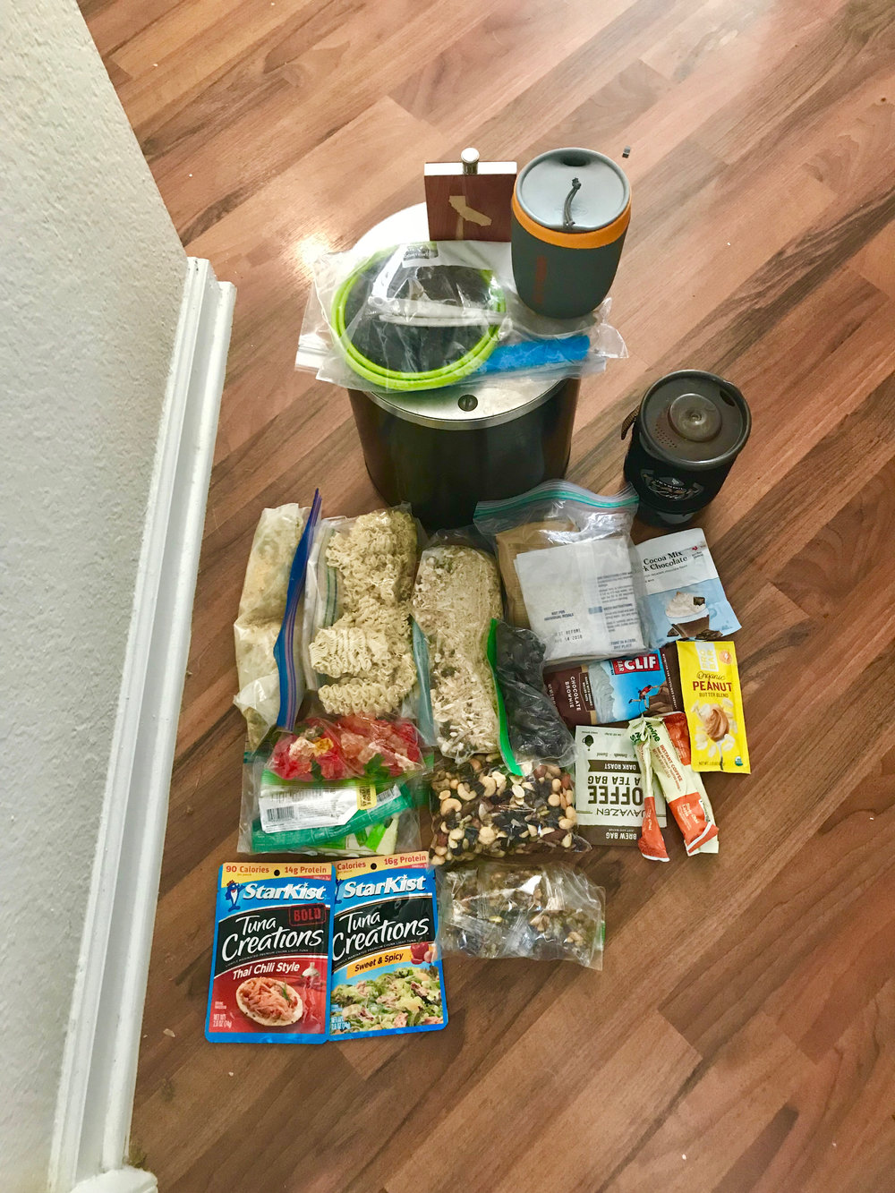 Food , stove, bear canister, cutlery and mug. Make sure you have enough calories to keep you warm on the trails.