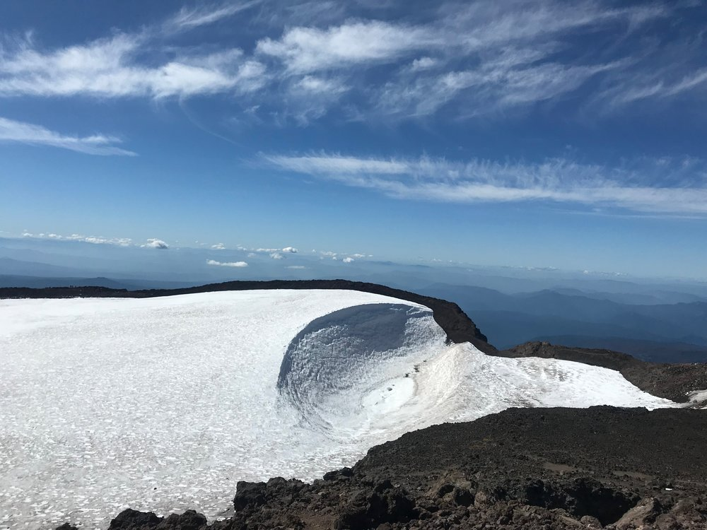 Summit of South Sister in Bend, Oregon. A snow filled caldera. A caldera is a large cauldron-like hollow that forms following the evacuation of a magma. So I am terrible at remembering the word  cauldron  but I always think of a witches pot to refresh my memory.