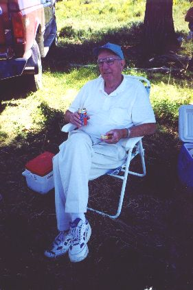 5. Made August 23, 1997 - Roy Tea at Muddy Creek, WY.  Photograph by Steve Berlin.   Roy Tea, seen here having lunch on the bank of the Muddy, guided the field trip along with John Eldredge. Apologies for the too dark snapshot.