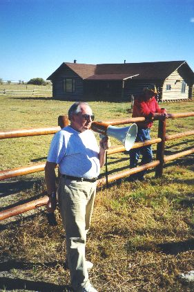 5. Made 10/18/97 , ~22 miles North of Wendover, UT at Donner Spring.George Ivory at Donner Springs. Photograph by Steve Berlin.  Utah Crossroads Chapter President, George Ivory, standing inside the fence erected by the chapter to protect the site, describes Donner Spring, its history and current status to the group. The spring is located on the Stephens Ranch and is open to the public. The chapter has provided printed literature at the here in addition to the interpretive signage.