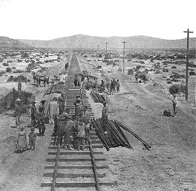 """9.Made 1869 in the Great Salt Lake Desert.Historical Photograph - Laying Track on Central Pacific RR near Lucin, UT. Photograph by Golden Spike National Historic Site in  Rails East to Promontory.   Chinese """"coolies"""" prepared the grade and Irish tracklayers put down the iron on the route across Utah toward the meeting of the rails at Promontory Summit. The Chinese were paid $30 - $35 per month and were credited with managing to save $20."""