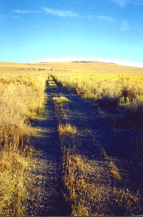 15. Made 10/18/97 about 24 miles west of Promontory Summit UT.Final Miles. Photograph by Steve Berlin.  Toward the end of the day, as the shadows lengthened and we neared Golden Spike National Historic Site at Promontory Summit colors deepened and we left behind the scattered vegetation of the semi-desert and traveled through thick grease-wood and bunch grass.