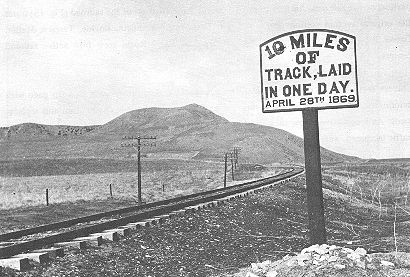 16. Made 1869 just west of Promontory Summit. Historical Photograph - Ten Miles of Track in One Day! Photograph by Southern Pacific Railroad in  Rails East to Promontory   The race to build its railroad was a high-stakes enterprise for each company. Work on parts of the grades had extended so far ahead of actual track-laying that the Central Pacific may have been building road in Wyoming while the Union Pacific graded into Nevada. Even after Promontory Summit had been chosen for the meeting of the rails competition remained high.  Early in 1869 Charles Crocker of the Central Pacific boasted that his crews could lay ten miles of track in a single day. UP workers laughed at the claim. On April 28, 1869 CPRR Chinese coolies and Irish track-layers set out to prove it. In a feat of organization, skill, strength and determination not equaled in the annals of railroad building before or since, by lunch these men had put down six miles of new track and by the end of the day the team had laid its full ten miles. Each track layer had lifted 125 tons of iron. Over 25,000 ties, more than 3,000 rails and 14,000 bolts had been set. To prove the road was good an engine ran up and back at high speed. A sign still commemorates the men's epic accomplishment.
