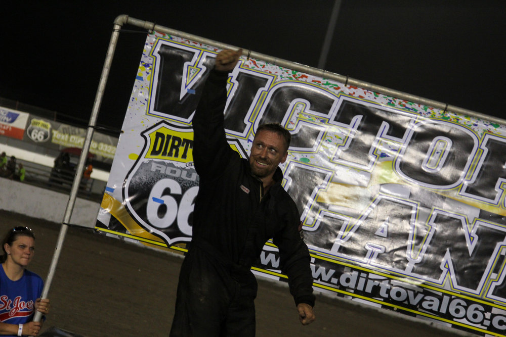 Jeremy Nichols in victory lane after picking up the inaugural Chicagoland 20 at The Dirt Oval at Route 66.  A.E. Blair Photography Photo