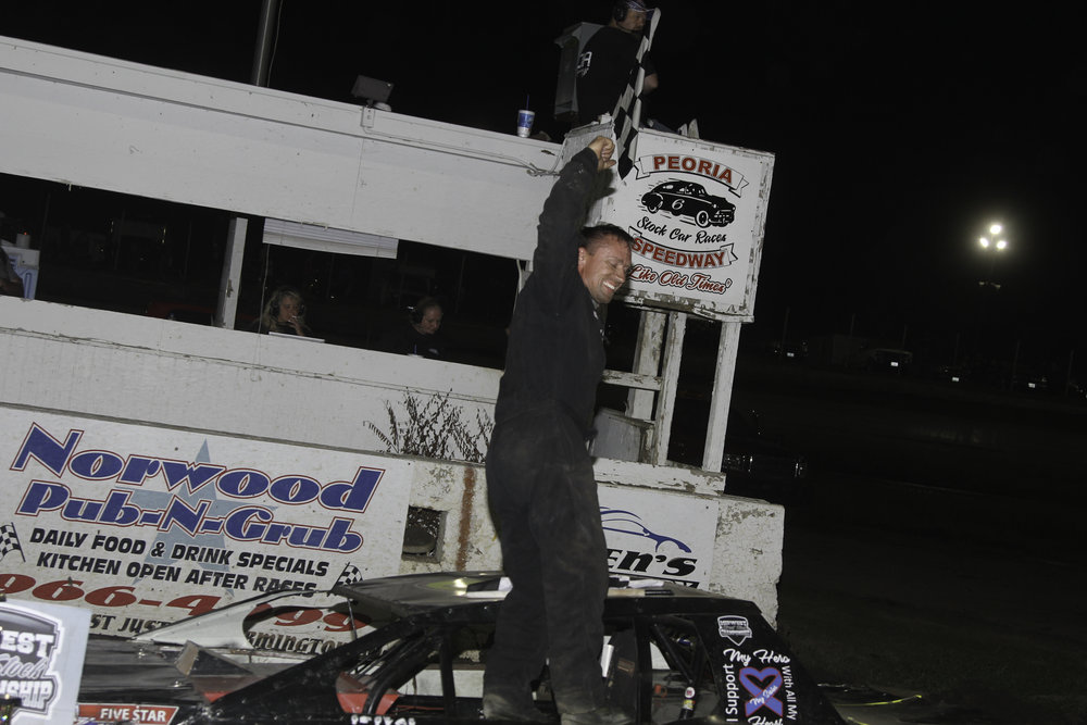 Jeremy Nichols celebrates after capturing a hard fought victory in the Dirty 30 at Peoria Speedway.  A.E. Blair Photography Photo