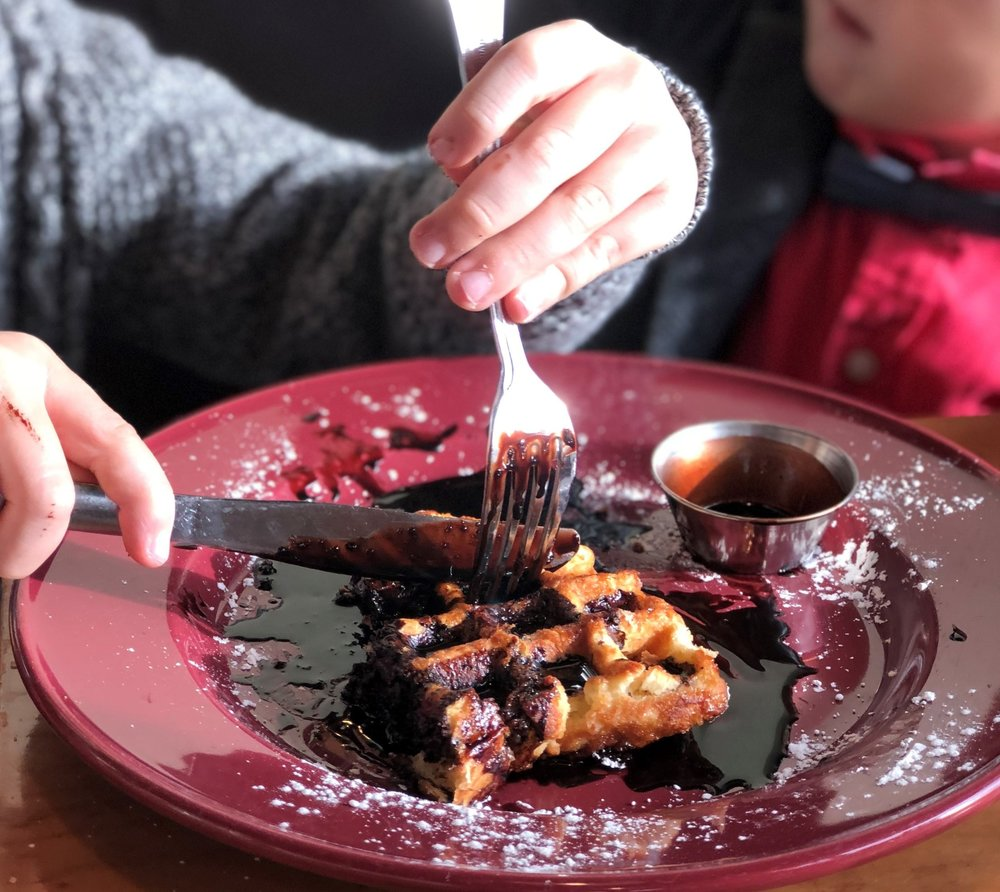 My nephew digging into an Original waffle with chocolate sauce. The kids LOVE this place!
