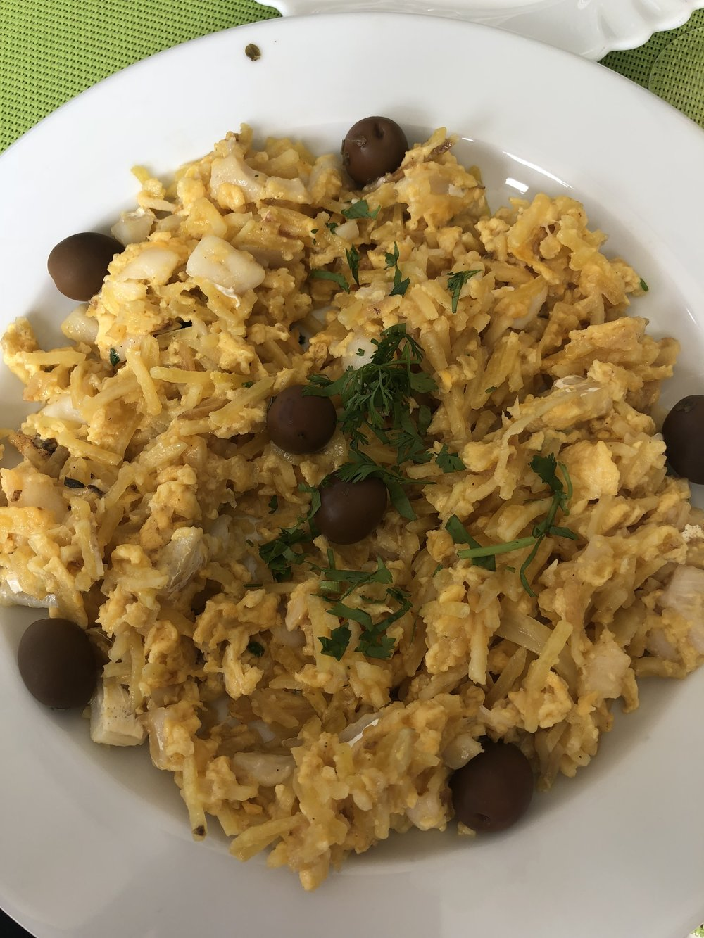 Bacalhau a Bras - rice and seafood (mainly cod) dish. Mine was also garnished with olives :)