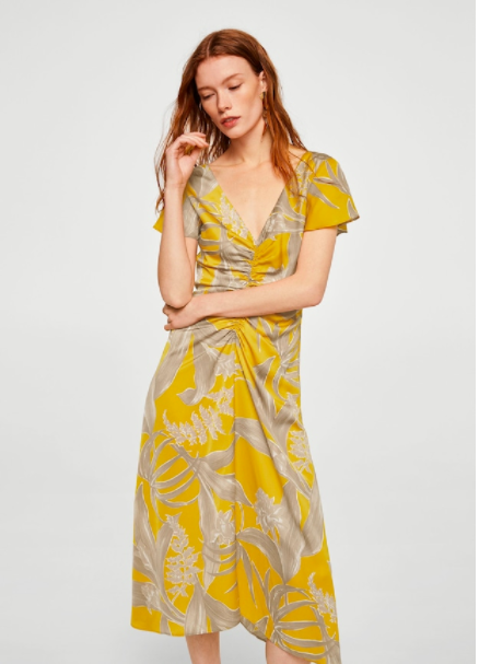 Delicate Yellow Foral - This gorgeous mustard colored dress with gathered v-neck and flounced sleeves is definitely unconventional, with its muted grey florals. Available at Mango.