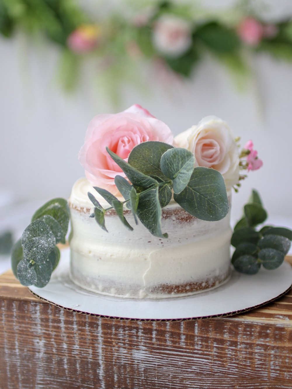 Vanilla Cake:  Brooklyn Sweet Spot  Decorated with silk flowers and eucalyptus leaves from  Michael's