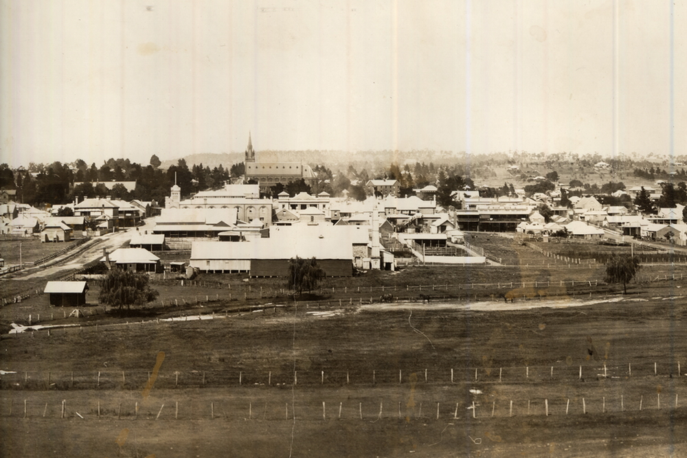 Panoramic photo of Armidale looking south to the Catholic cathedral with grazing in the creekland area - 1922