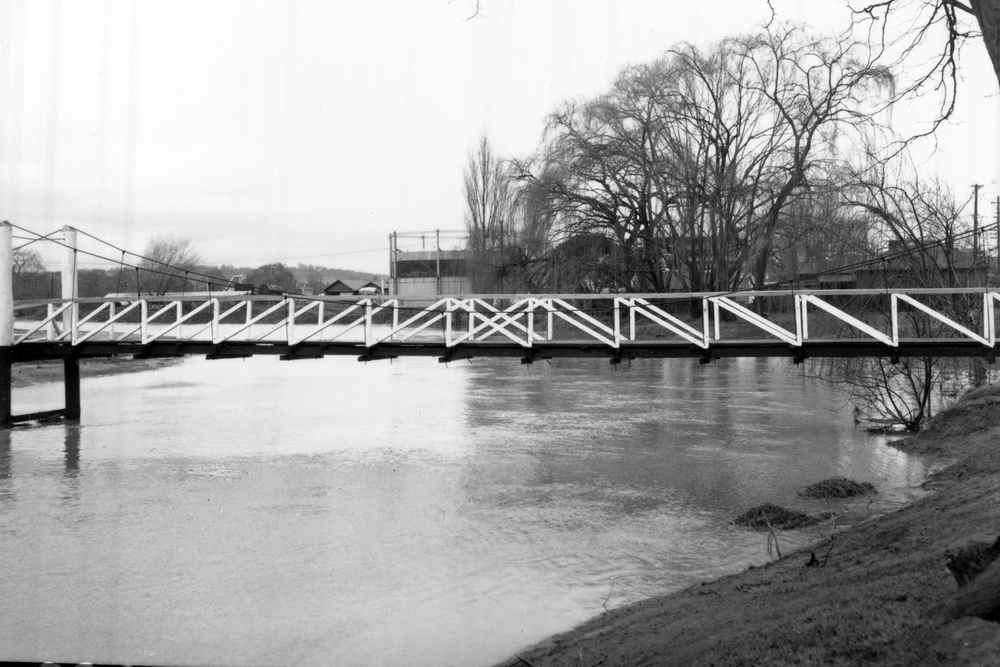 Flood waters under foot bridge south of swimming pool and north of TAFE in Dumaresq St - 1964
