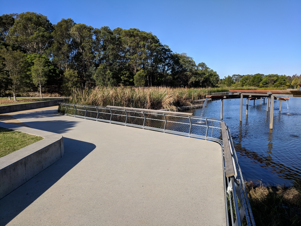 Wide walkways with secure fencing near deep water features