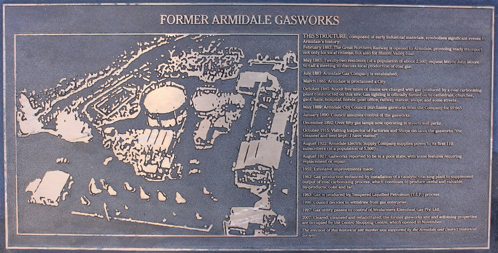Plaque below sculpture noting position of old gas works