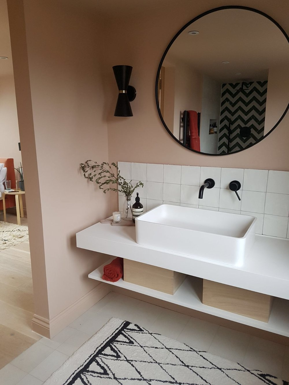 The end result - The bathroom with a little view into the main bedroom area