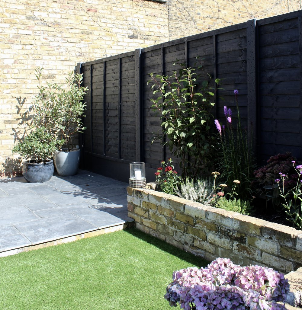 To create a dramatic background for the planting, we chose  Cuprinol's Urban Slate  for the fencing. It coordinates beautifully with the naturally blue-grey slate paving