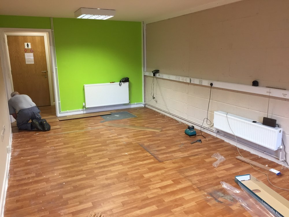 The walls look great with a fresh lick of paint, but it was definitely time for this tired old flooring to go