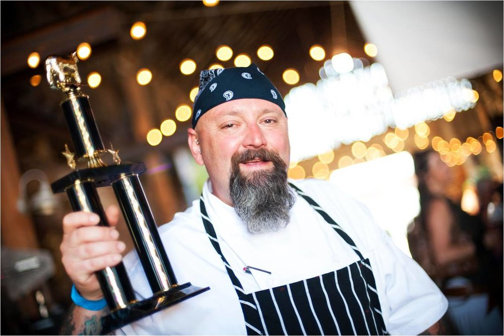Brian Alberg- holding trophy.jpg