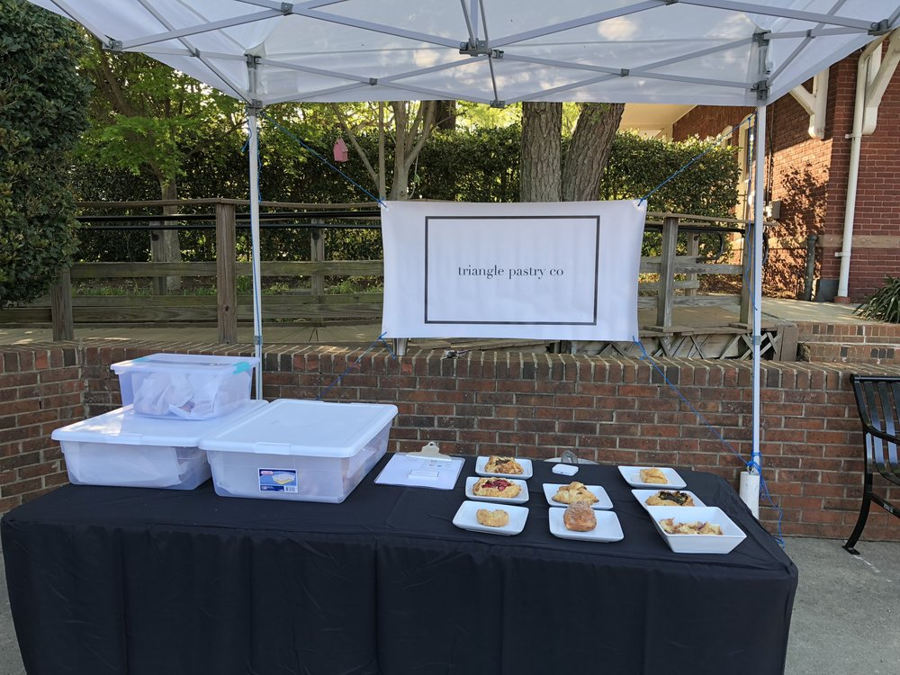 Setting up the Triangle Pastry Co tent at the Apex Farmers Market.