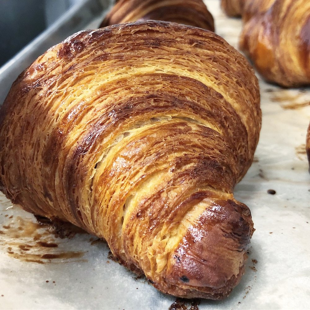 Layers of love: Our fresh flaky croissants straight out of the oven.