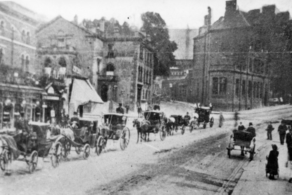 Cabs waiting outside Blackheath station. 19th Century.