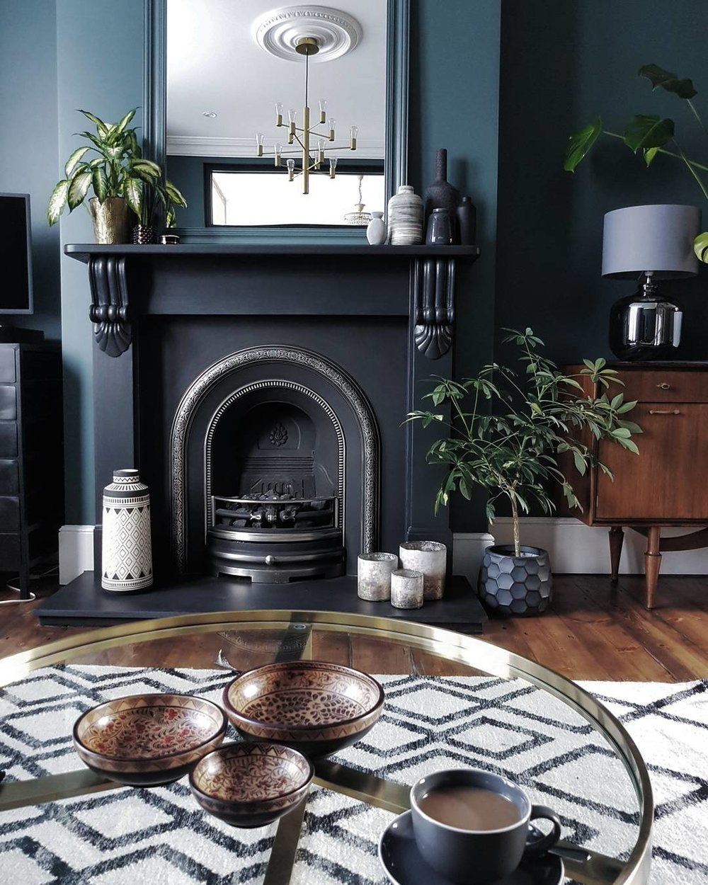 Glass table - Made.com ..... Rug- Debenhams ..... Hurricane vases on the hearth - Nordic House