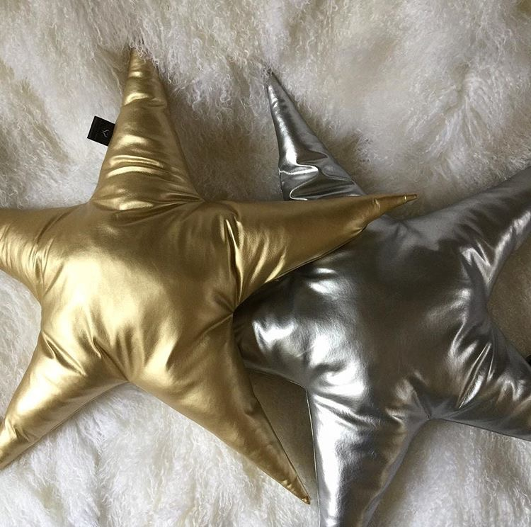 Handmade star cushions- £65.00   Measuring 70 cm from point to point, they are available in silver and gold leatherette fabric and Blue Serenity & Rabbit Alaska faux fur.   www.suburbansalon.co.uk
