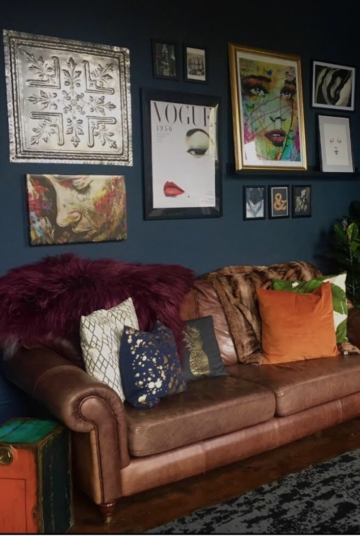 I love this gallery wall in the home of   @skullandcactus   ...... Amy has used Valspar '  Thundering Clouds'   for the dark blue backdrop to her wonderful gallery, I too have a brown leather sofa against dark blue walls. Doesn't it look great!