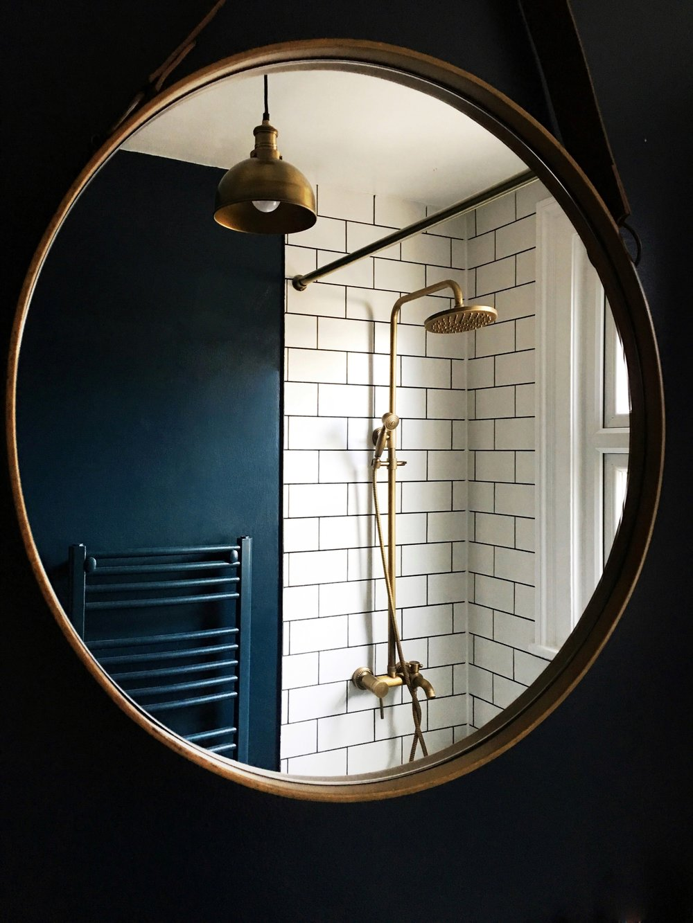 Ruthies Bathroom really is a thing of beauty, she has used Hague Blue against those fabulous brass fittings and metro tiles to great effect- i love that she has painted the towel rail too to blend  in with the dark walls   @design_soda_ruthie