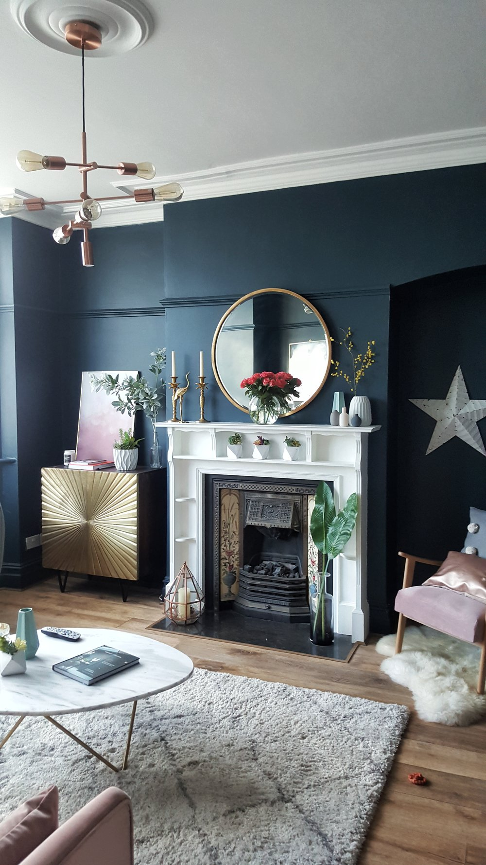 The Hague Blue walls in the beautiful Sitting Room of    @my_london_home   look fabulous with the gold and pink touches, dark blue and gold what a combo!